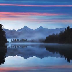 Mirror reflection Lake Matheson Aoraki Mount Cook, Mirror in Fox Glacier National Park New Zealand, natural landscape background. Beautiful New Zealand landscape background.
