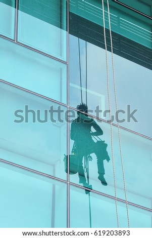 Mirror reflection of Window washer high office building #619203893