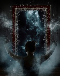 Mirror. Terrible ghost on dark smoke background