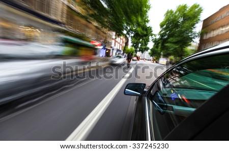 Mirror view of speeding car. #337245230