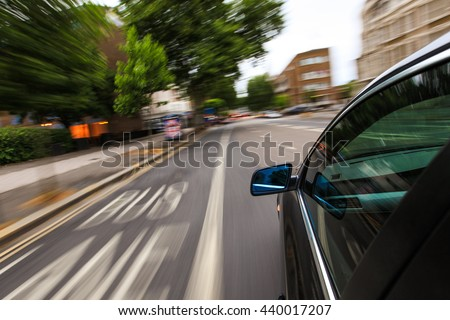 Mirror view of speeding car. #440017207