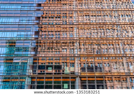 mirroring skyscraper in the windows of a skyscraper #1353183251