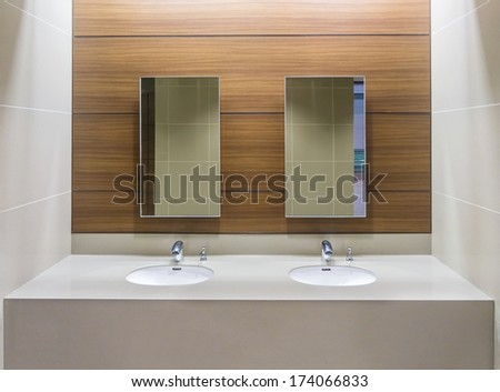 mirrors and washbasins in...
