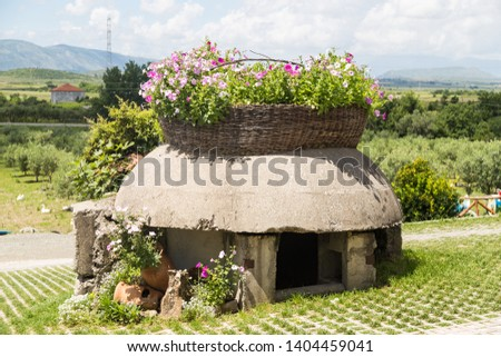 Mirzi i zanave,Albania. Bunkers in Albania decorated with flowers