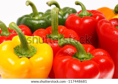 Miscellaneous colored peppers on white background