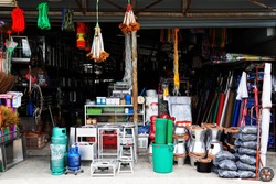 Miscellaneous street shop. Traditional of store front of miscellaneous shops that selling charcoal burning stove, folk fishing tools, and household items for street cart hawkers and houses. Thailand.