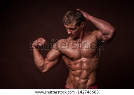 Miscled male model in studio