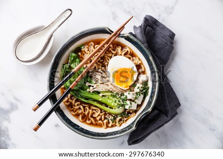Miso Ramen Asian noodles with egg, enoki and pak choi cabbage in bowl on white marble background  ストックフォト ©