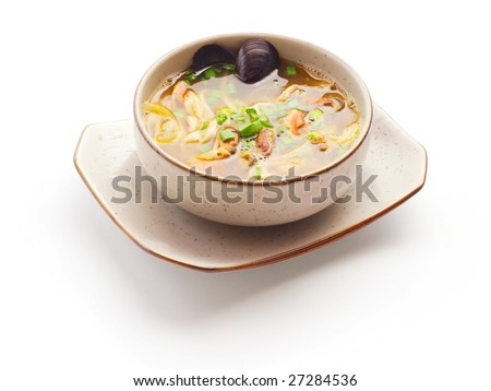 Miso soup with mussel and onion in small dish over white background