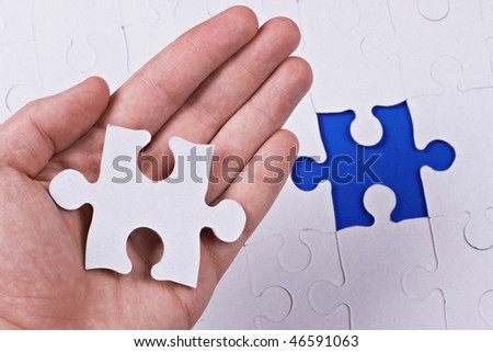 Missing part of puzzle in hand.