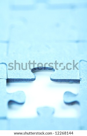 Missing piece of puzzle. Focus on the upper part of the puzzle hole.