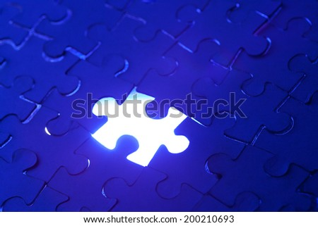 Missing puzzle piece with light glow