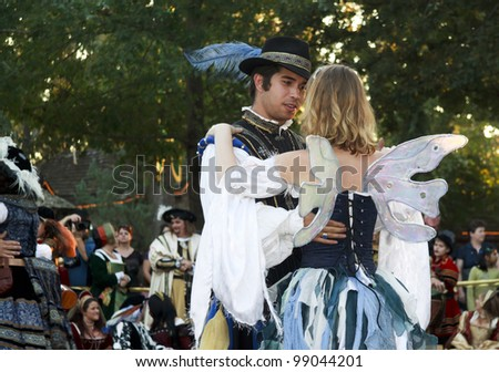 MISSION, TX - OCTOBER 17: Couple dancing at the Texas Renaissance Festival, known as the largest in the state and taken on October 17, 2009 in Mission, Texas.