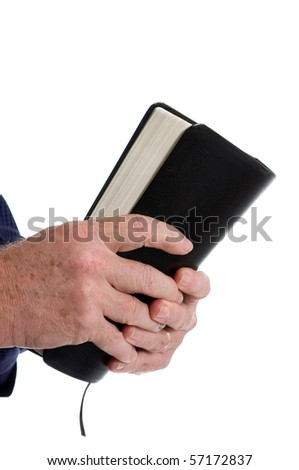 Missionary man's hands clutch Holy Bible. Isolated on white. Room for copy at top.