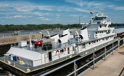 Mississippi Barge Boat:  A towboat pushes freight barges through a lock on the Mississippi River.