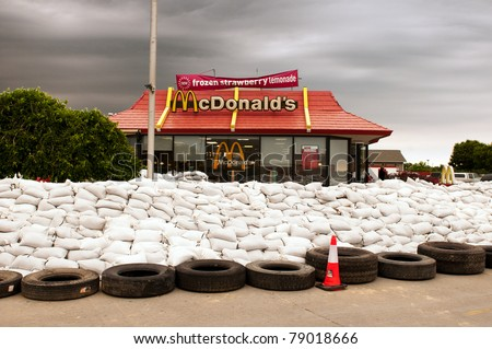 stock-photo-missouri-valley-ia-june-a-local-mcdonald-s-restaurant-is-surrounded-by-sand-bags-in-defense-79018666.jpg