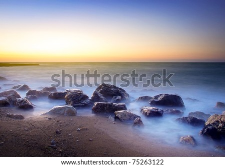 Mist amongst stone on seashores. Composition of the nature