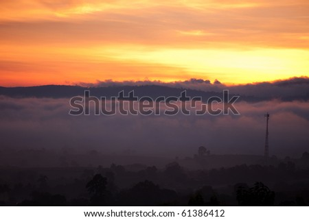 Mist in mount and jungle with telecommunication tower in sunrise