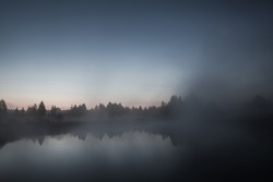 mist over the lake, dusk over the lake, a very dense fog, dawn, blue sky over the lake, the morning comes, the forest reflected in the water, surface water, clear morning sky, gothic