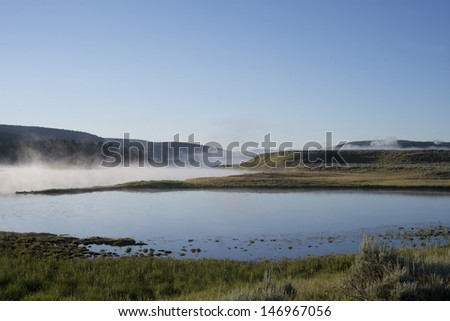 Mist rises from the Yellowstone River at Dawn.