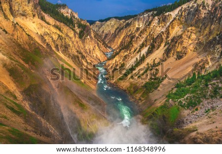 Mist rises up into the Grand Canyon of the Yellowstone from the brink of Lower Yellowstone Falls, Yellowstone National Park, Wyoming, USA.