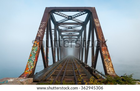 Misty fog on the Ottawa River conspires with the structural steel of the Prince of Wales railway bridge to create an eerie and hazardous crossing ..