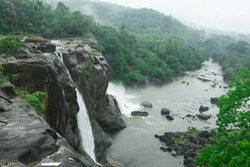 Misty forest and rocks, soothing Athirapally Vazhachal waterfall in Kerala South India. holiday location. color greenery 2017 nature Indian