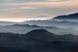 Misty hills and canyons in the San Gabriel Mountains foothills north of Los Angeles in scenic Southern California.