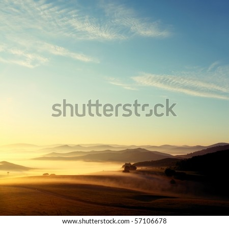 Misty layered mountains in sunrise
