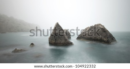 Misty Morning at Sea with rocks