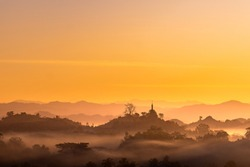 misty morning, fog rolling through the village of Mrauk U in the remote part of Myanmar. Ancient temples are a big tourist destination.