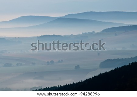 Misty morning in a valley in the Czech Republic. - stock photo