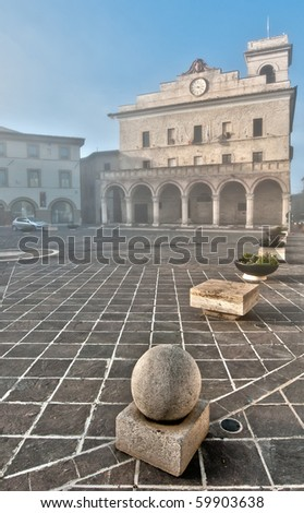 Misty morning in main square, Montefalco, Italy