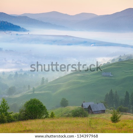 Misty morning in the Carpathian mountains village. Sunrise