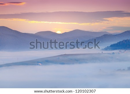 misty morning in the mountains. sunrise