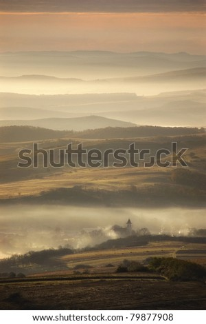 misty morning over a small village