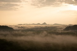 misty morning sunrise, Landscape view of Khao Na Nai Luang temple on peak mountain at Surat Thani Province, Southern of Thailand