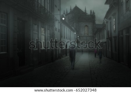 Misty old european town with blurred people walking on cobbled sidewalk
