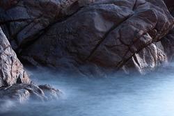 Misty rocky sea shore in Corsica