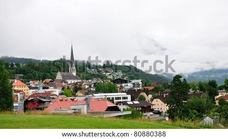 Misty small town in alpine valley, Imst, Austria