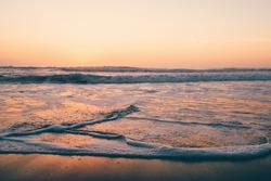 Misty Sunset over Calm Ocean Waves