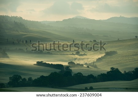 Misty Tuscan hills one early morning town of Pienza Italy