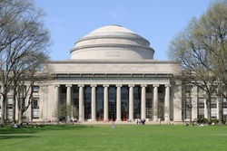 MIT (Massachusetts Institute of Technology) in the spring. Students relaxing on the lawn in front of Building 10