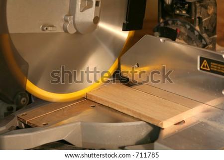 miter saw cutting wood