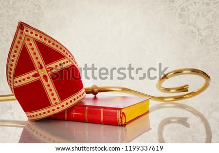 Mitre or mijter and staff of Sinterklaas.On vintage backgroud. Dutch tradition saint Nicholas