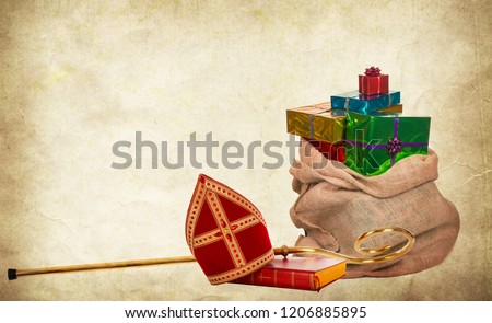 Mitre or miter book, gifts and staff of saint nicholas. Vintage paper background