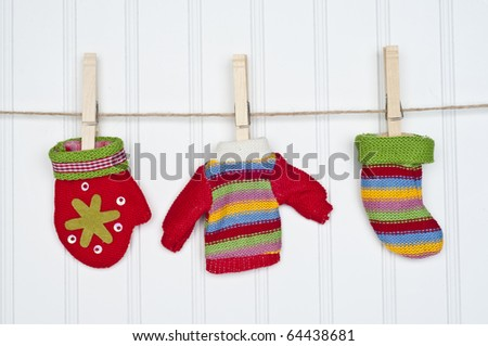 Mitten, Sweater and Warm Sock on a Clothesline.  Holiday Concept.