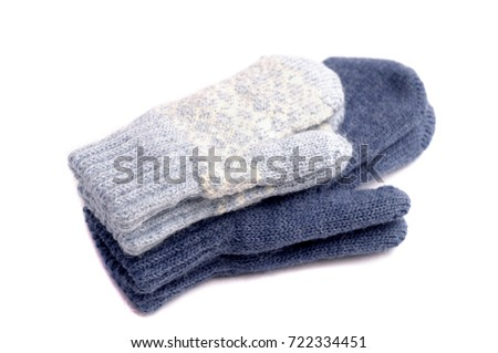 Mittens isolated on white background. Knitted blue mittens.  #722334451