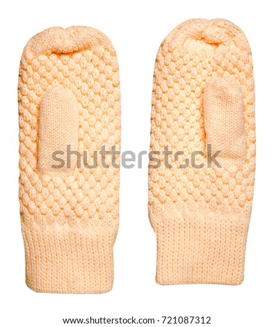 Mittens isolated on white background. Knitted mittens. Mittens top view. #721087312