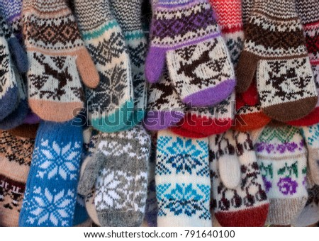 Mittens on the winter Christmas market. Multi-colored knitted woolen mittens. #791640100